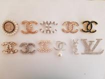 Broșe și cercei Chanel