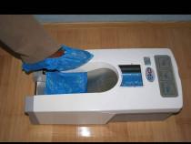 Dispenser pentru acoperitori încălțăminte ( botosei ).