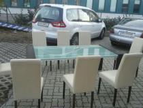 Masă de sticlă cu scaune de piele