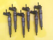 Injectoare bmw e60 e61 e70 e63 e65 cod 7792721