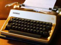Masina de scris aurie, eleganta
