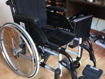 Carut scaun cu rotile handicap dizabilitati