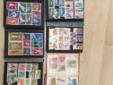 Colectie timbre romanesti si straine,6clasoare mari,2mici.