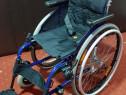 Carut scaun cu rotile copii dizabilitati handicap