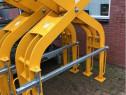 Graifer mecanic de manipulare pentru poduri rulante