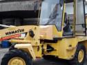 Buldoexcavator Komatsu WB92A an 2000. Ore 5000