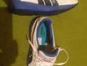 Adidas marca puma